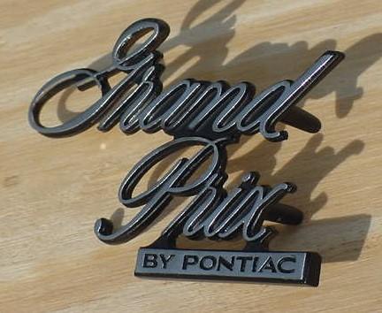 Pontiac 77 Grand Prix Header emblem NEW